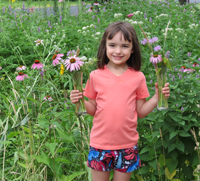 Natalie with flower bouquets - WI Monarch Champion